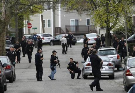 Police officers searched homes for Dzhokhar Tsarnaev in Watertown on April 19, 2013.